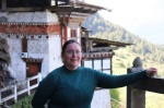 Amber smiling in front of a temple in Bhutan, happy to have chosen this country for her first time international travel